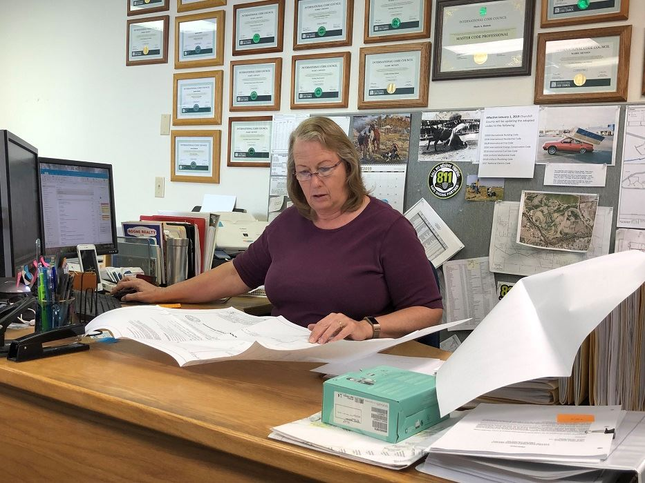 Marie Henson at her work desk