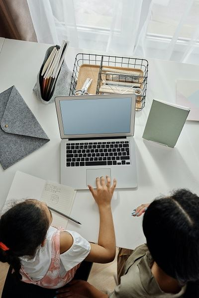 Overhead view of child using laptop